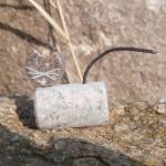 kleine Steinkatze, liegend