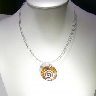 Wunderschöner, polierter Bernsteindonut mit einer Spirale aus Silber (925 )
