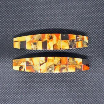Wunderschöne Haarspange aus verschiedenfarbigen, flachen Bernsteinen